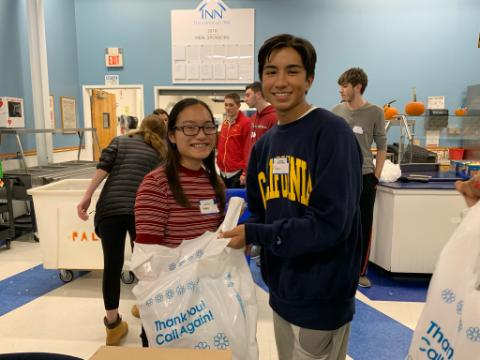 Members of SPARC help to bag Thanksgiving goods for the INN