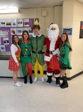 Ms. Kelly and the Student Organization dressed up for Christmas!